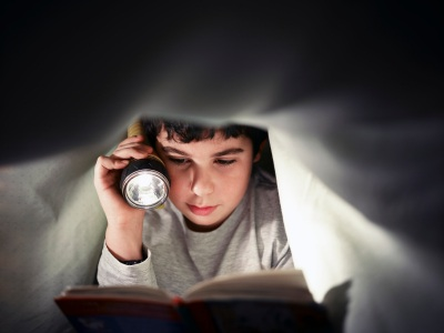 BLOG- kid reading under covers